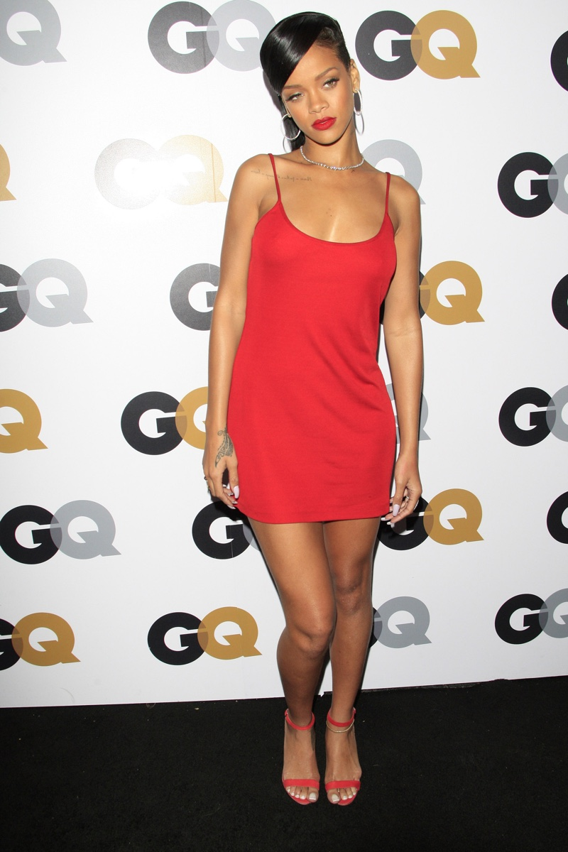 Rihanna was not afraid to wear siren red with this mini Calvin Klein slip dress. The singer paired the look with strappy red heels. Photo: Featureflash / Shutterstock.com