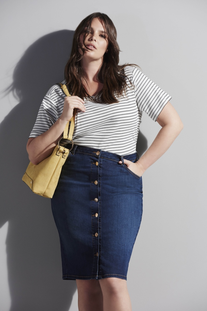 Photographed for River Island's curvy collection, Candice Huffine models a striped t-shirt and denim skirt with buttons