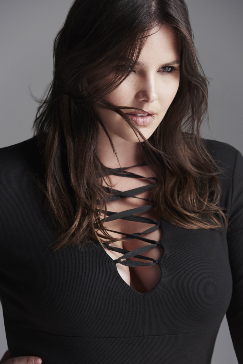 Candice Huffine wears a black lace-up top