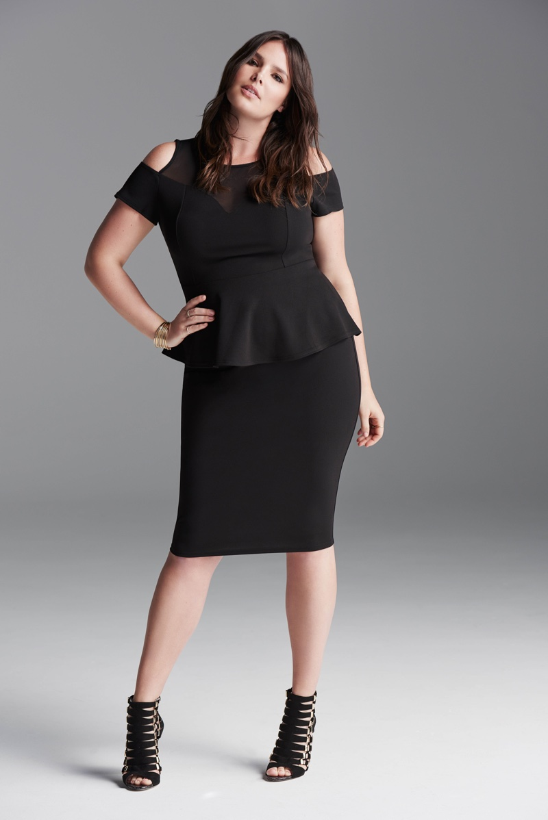 Candice Huffine shows off her figure in a black dress with cut-out shoulders and a peplum waist