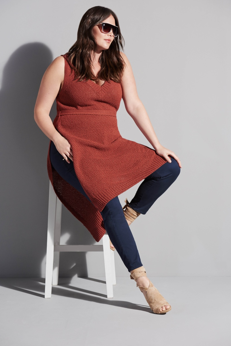 Looking casual chic, Candice Huffine models a long tunic and cropped denim pants from River Island