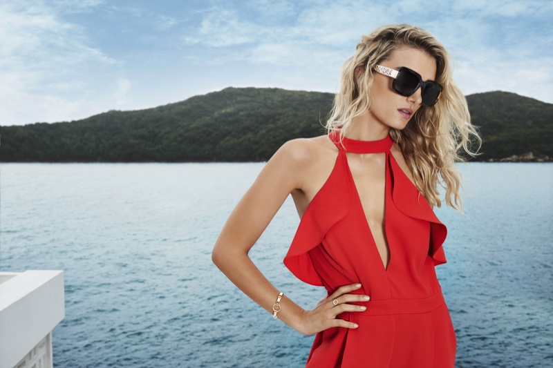 A lady in red, Lily models a red jumpsuit with ruffles and sunglasses from River Island