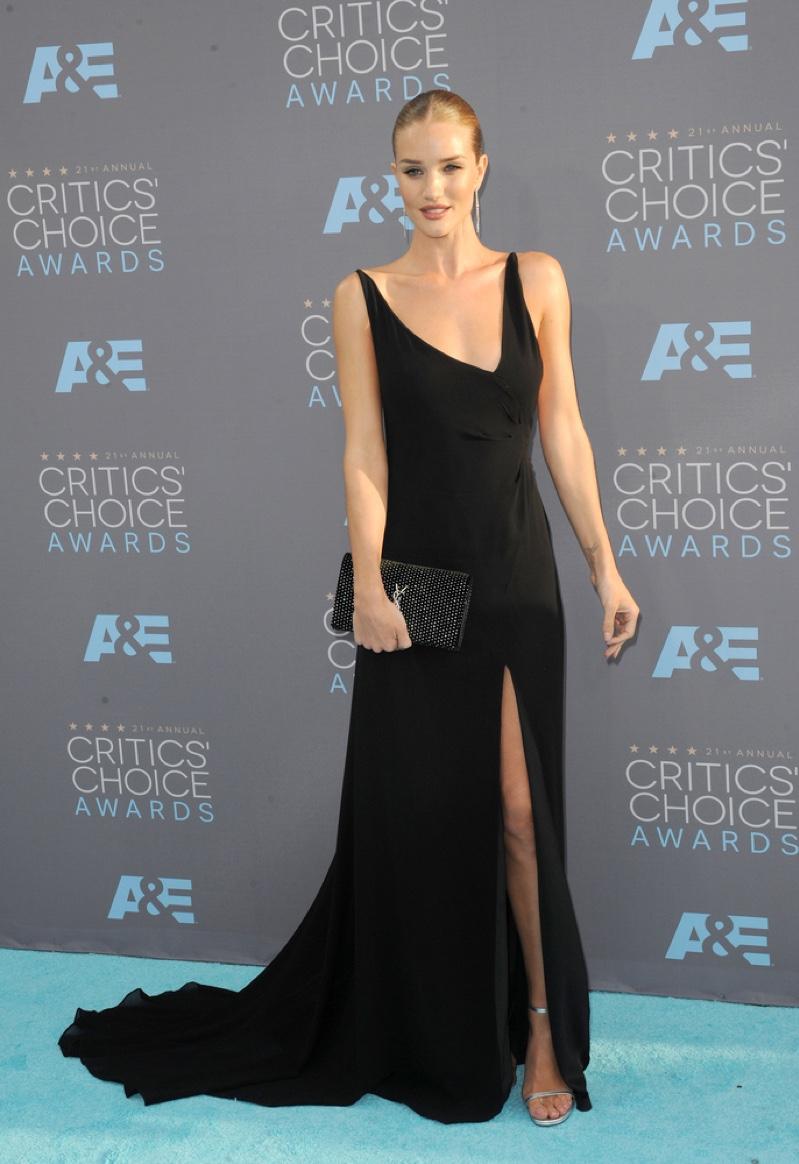 JANUARY 2016: Rosie Huntington-Whiteley attends the 2016 Critics Choice Awards wearing a black Saint Laurent dress. Photo: Tinseltown / Shutterstock.com