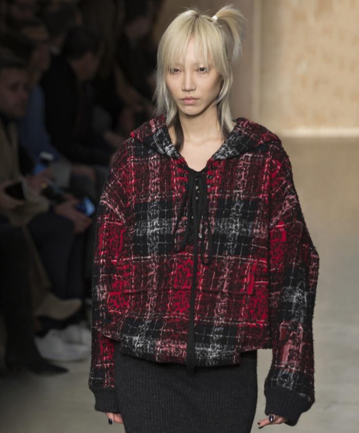 FEBRUARY 2016: Soo Joo Park walks the runway at DKNY's fall-winter 2016 show presented during New York Fashion Week wearing a plaid sweatshirt. Photo: Ovidiu Hrubaru / Shutterstock.com