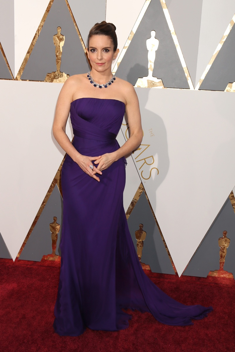 Tina Fey attends the 2016 Oscars wearing a strapless Versace gown in purple with Bulgari jewelry. Photo: Helga Esteb / Shutterstock.com