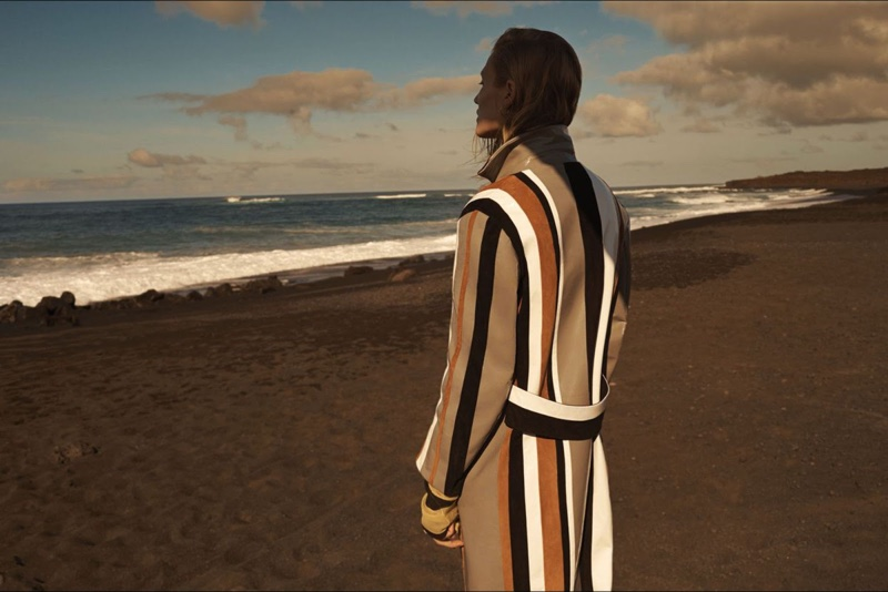 Toni Garrn shows off a striped coat from the back
