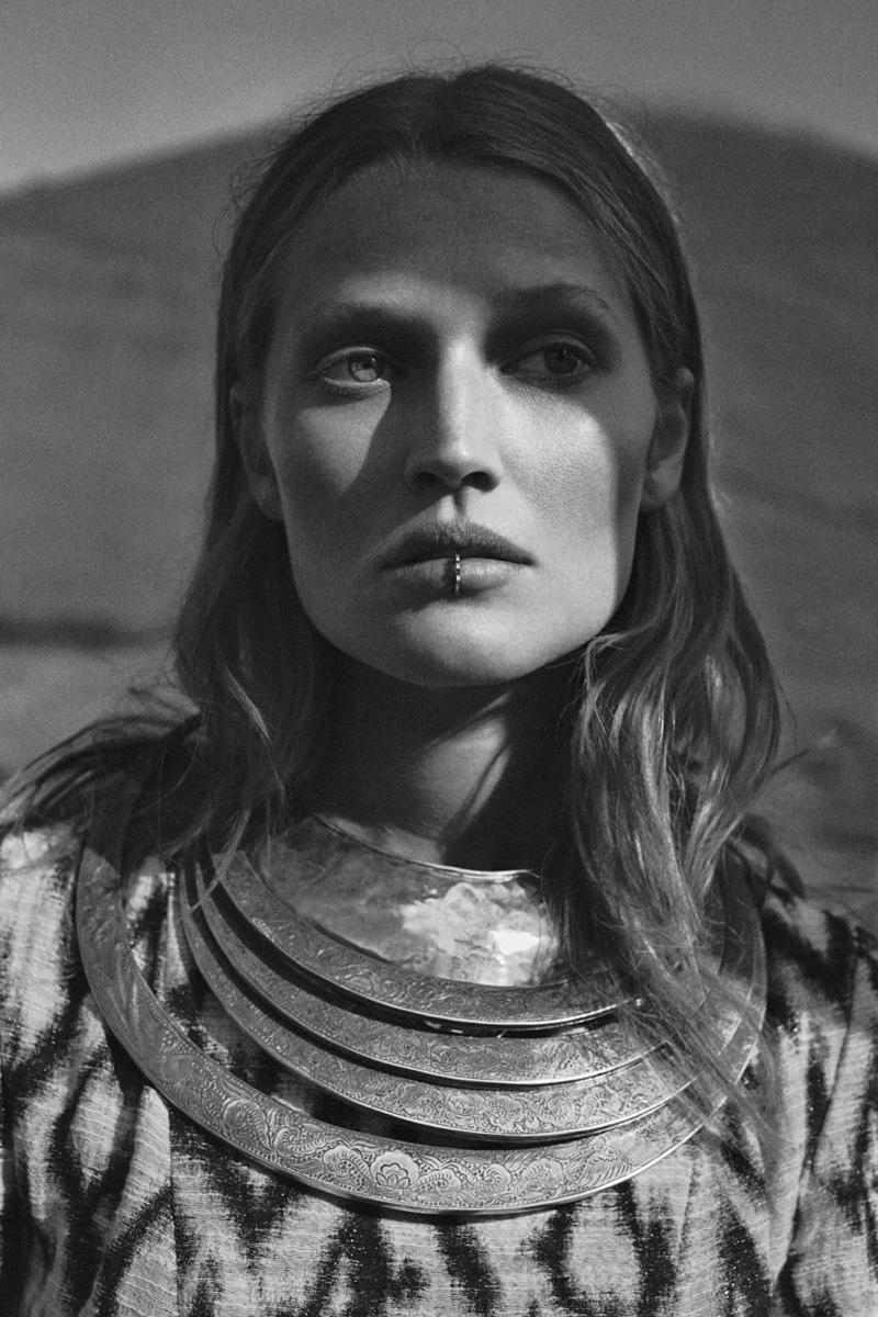 Toni models a layered bib necklace with lip jewelry