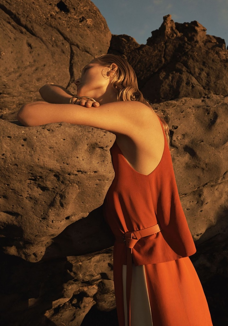 Toni Garrn poses in an Hermes top and skirt