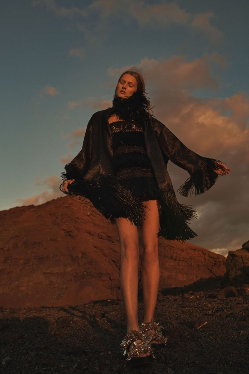 Posing with the wind, Toni wears a bell sleeve dress in black