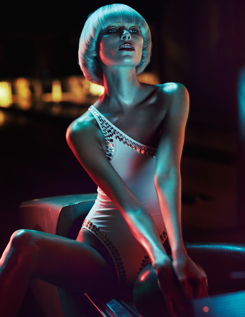 Photographed by Marian Sell, Vika Falileeva models a one shoulder white bodysuit with stud embellishments