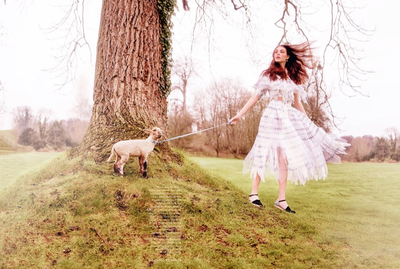 Posing with a goat, Vittoria Ceretti models an organza Chanel dress with frayed hemlines