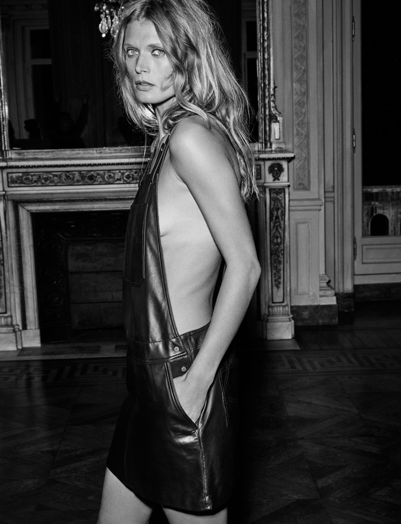 Photographed by Fred Meylan, the model wears skin-baring overalls in black