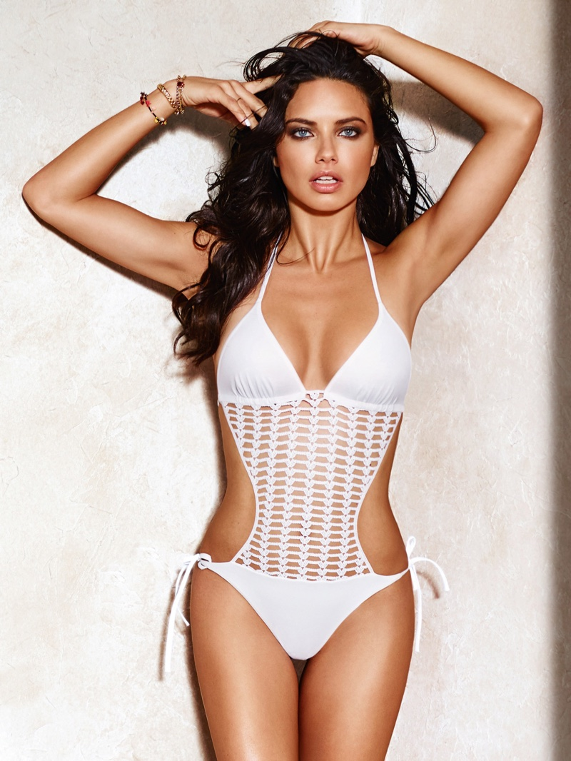 Photographed by Russell James, Adriana Lima wears a white monokini from Calzedonia