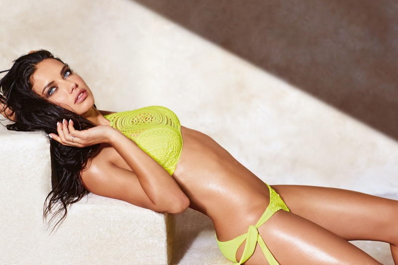 Adriana Lima models a halter bikini top with draw string bikini bottoms from Calzedonia