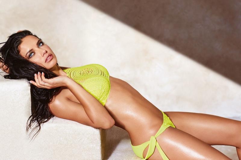 Adriana Lima models a halter bikini top with draw string bikini bottoms from Calzedonia