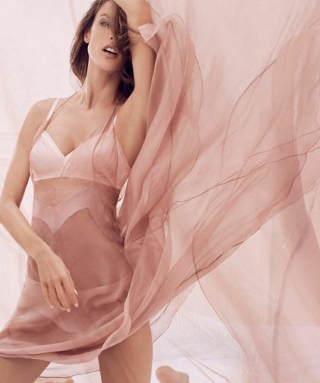 Looking like a dream girl, Alessandra models a sheer dress with white lingerie