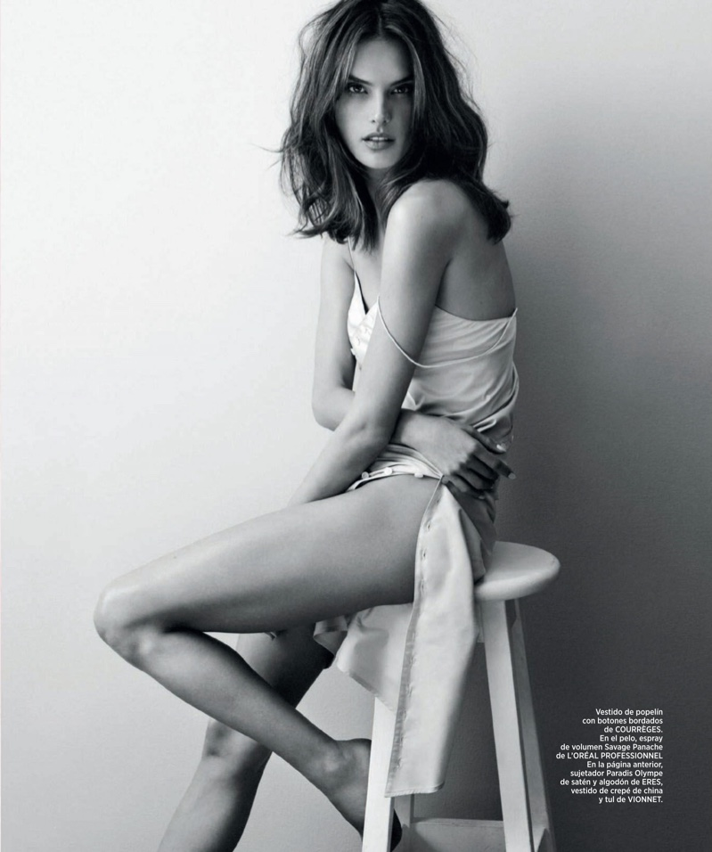 Sitting on a stool, Alessandra models a poplin slip dress from Courreges