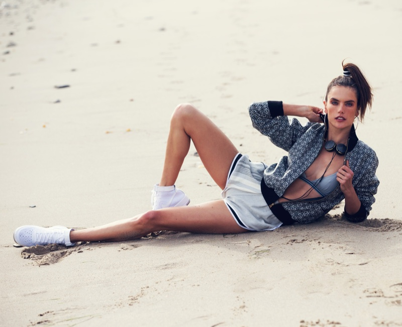 Alessandra Ambrosio channels 90's style in a Loewe jacket, La Perla Bra, Koza shorts and Nike sneakers