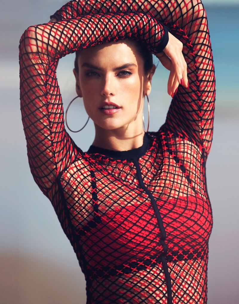 Posing with hoop earrings, Alessandra models a mesh Alexander Wang top and red T by Alexander Wang bra top