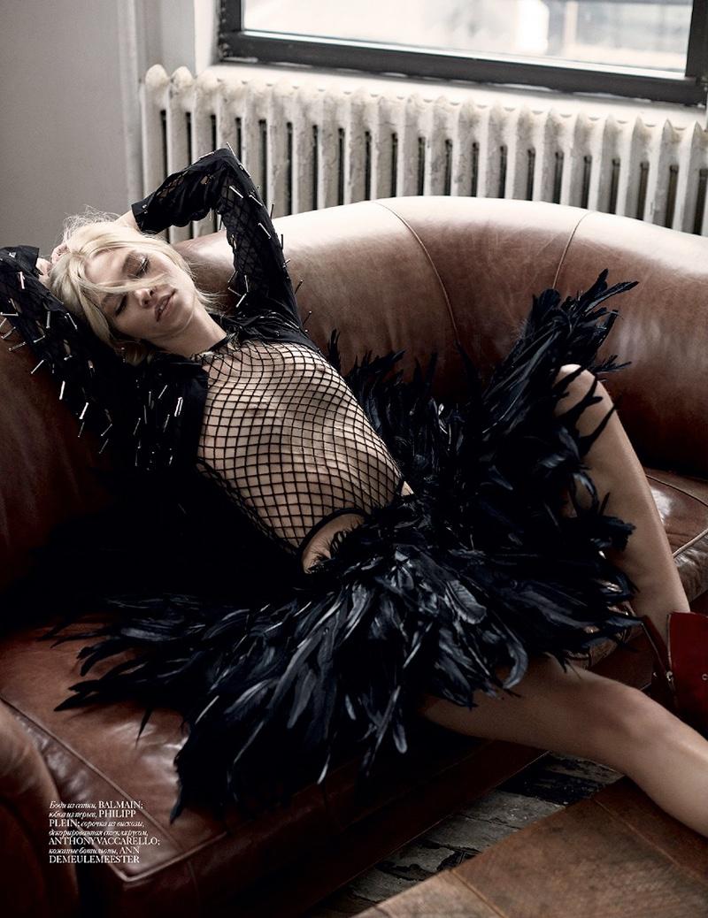 Aline channels her inner rocker girl in a mesh bodysuit and feathered skirt (designed by Philipp Plein)