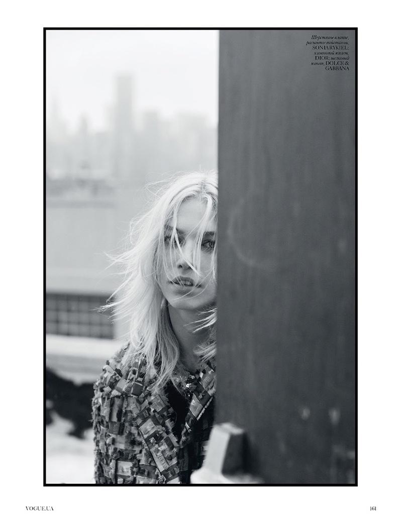 Peering around a corner, Aline models the designs of Sonia Rykiel, Dolce & Gabbana and Dior