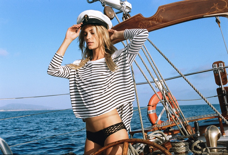 Sporting a sailor cap, Barbara gets nautical in a striped knit top
