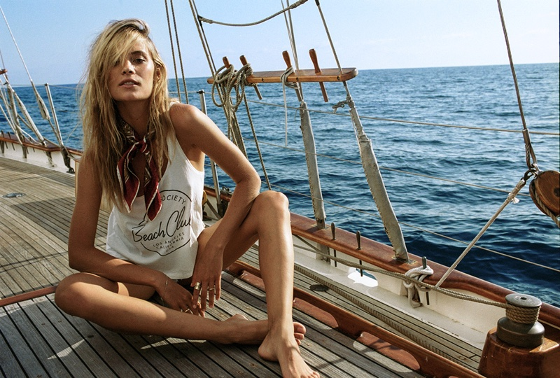 Lounging on a boat, Barbara wears a graphic t-shirt from Amuse Society