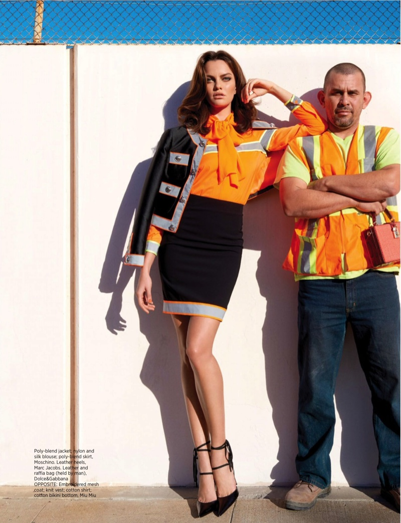 Posing next to a construction worker, Barbara Fialho models a Moschino jacket, silk blouse and mini skirt with Marc Jacobs heels