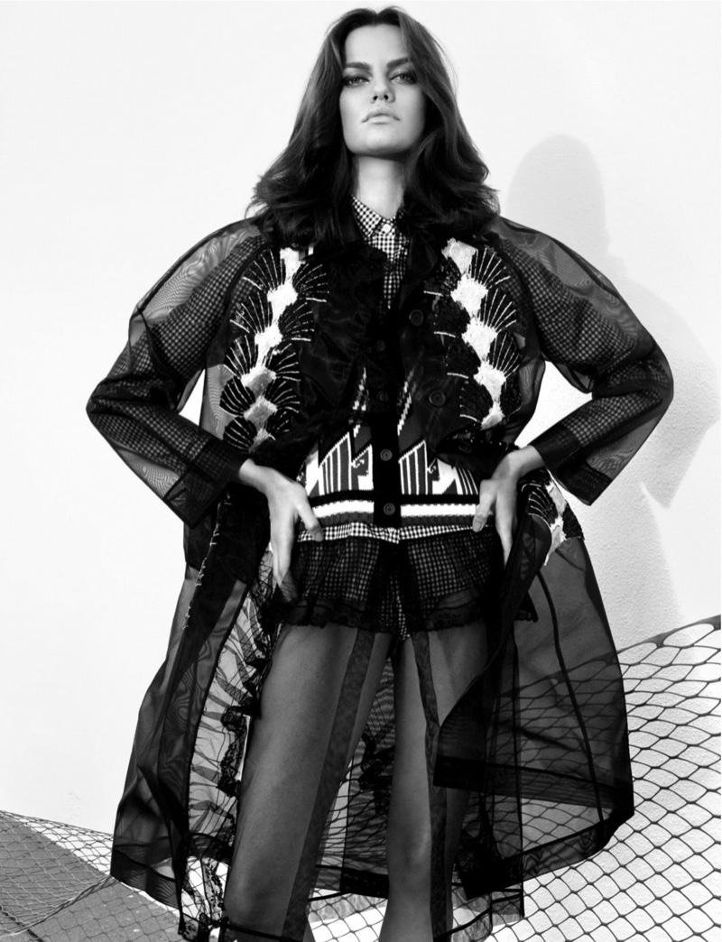 Photographed in black and white, Barbara models a layered ensemble by Miu Miu