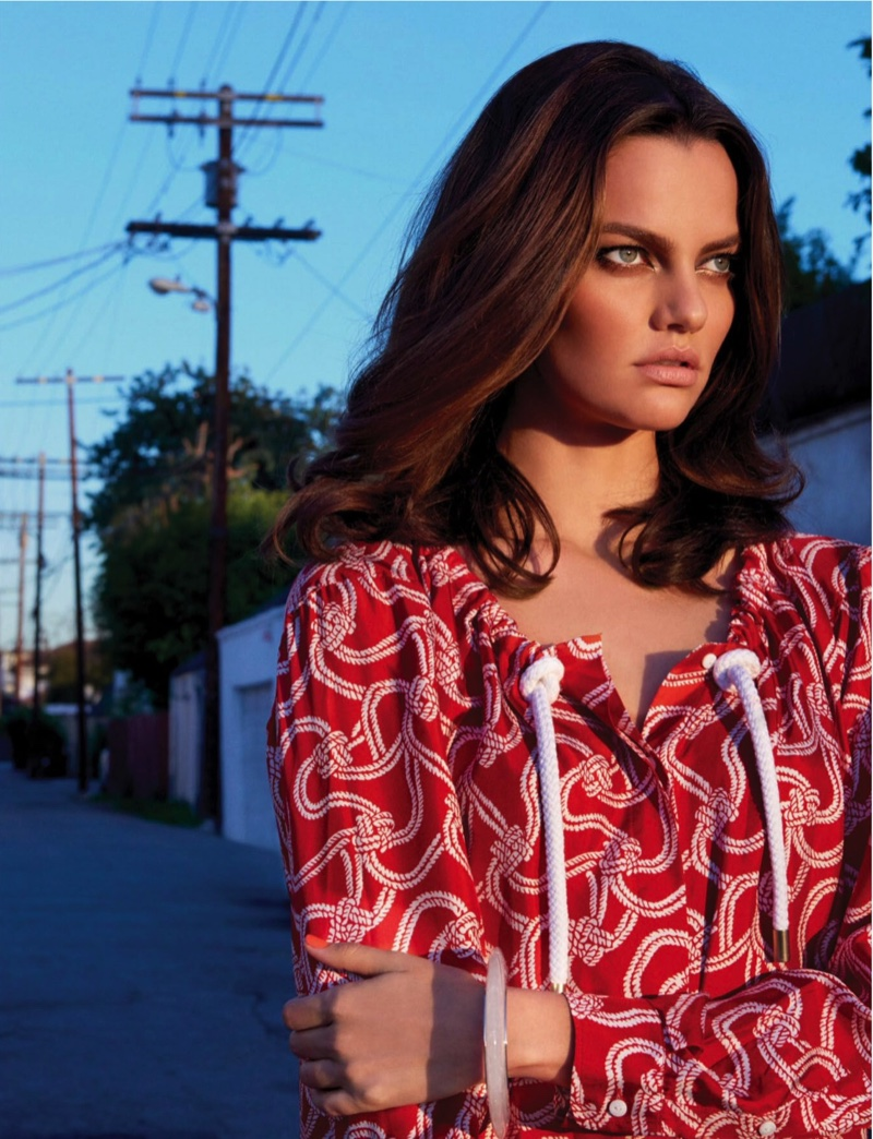 With her arms crossed, Barbara Fialho wears a red printed Max Mara top and Hermes bangle