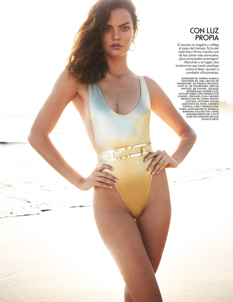 ... Barbara Fialho flaunts her toned figure in a gold Norma Kamali one-piece swimsuit