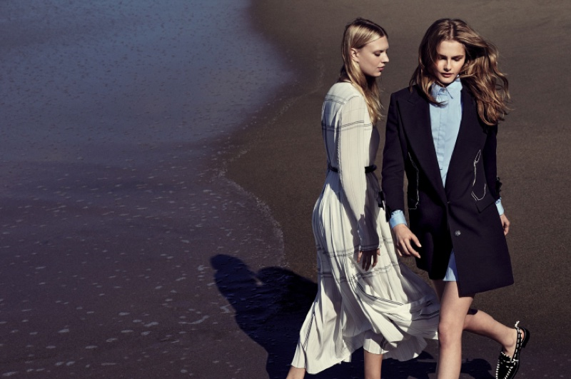 The models star in a fashion editorial featuring layered beach looks
