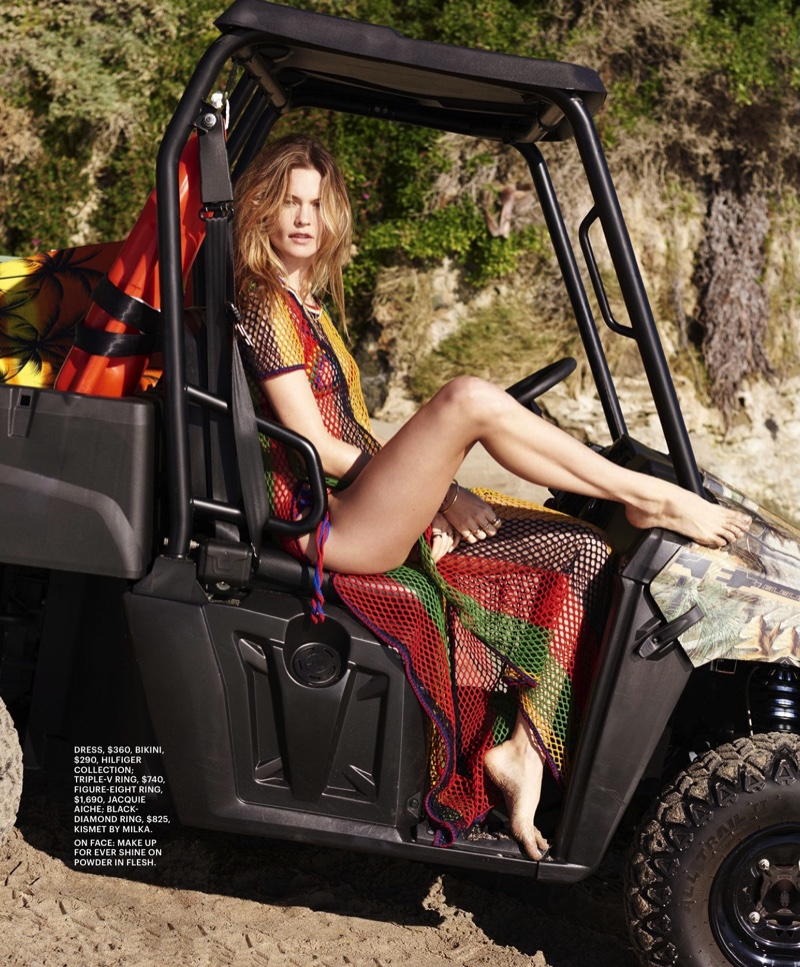 Posing in a striped beach cover-up from Tommy Hilfiger, Behati lives the island life