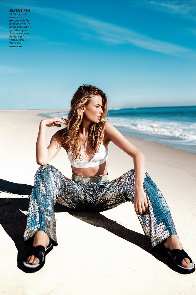 Behati Prinsloo keeps it casual in a Rag & Bone bra top and sandals with silver pants from Loewe