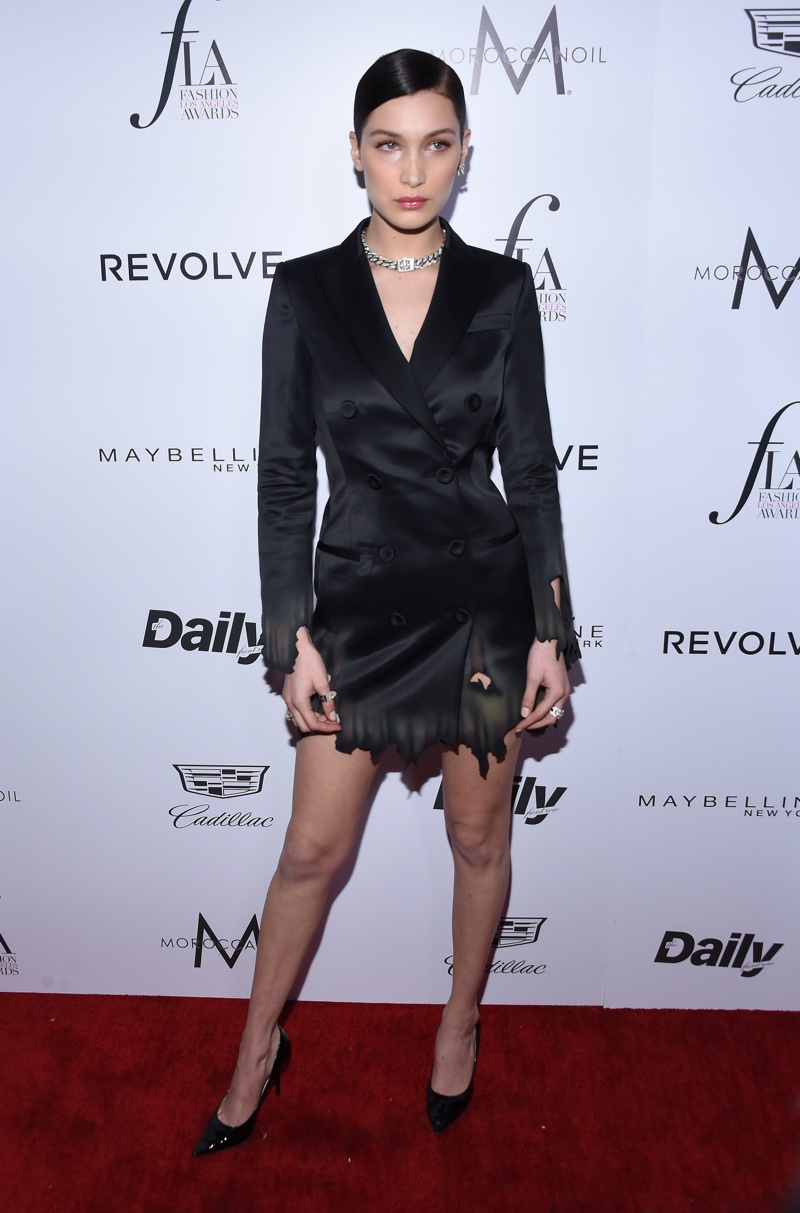MARCH 2016: Bella Hadid attends the 2016 Daily Front Row Los Angeles Awards wearing a black Moschino jacket dress. Photo: DFree / Shutterstock.com
