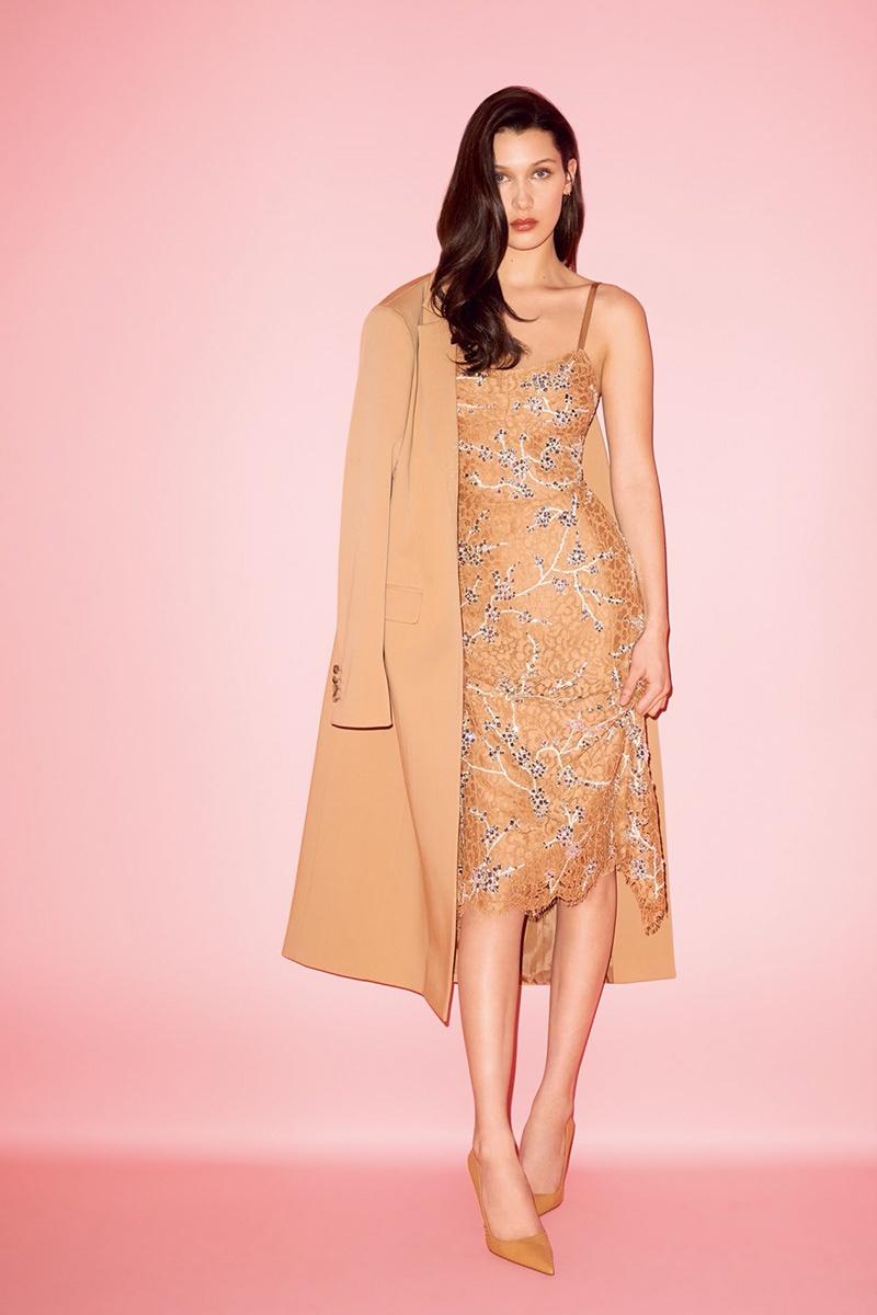Bella Hadid poses in brown coat and embellished slip dress