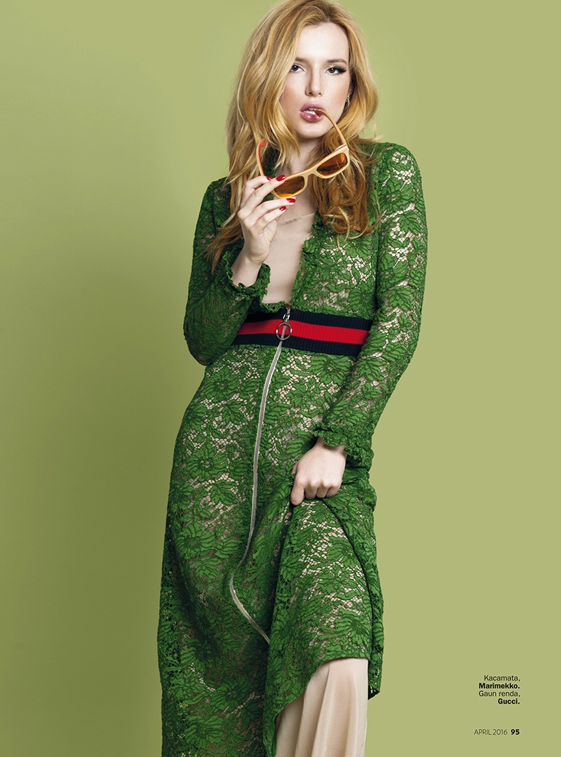 Bella Thorne looks lovely in a green lace dress from Gucci
