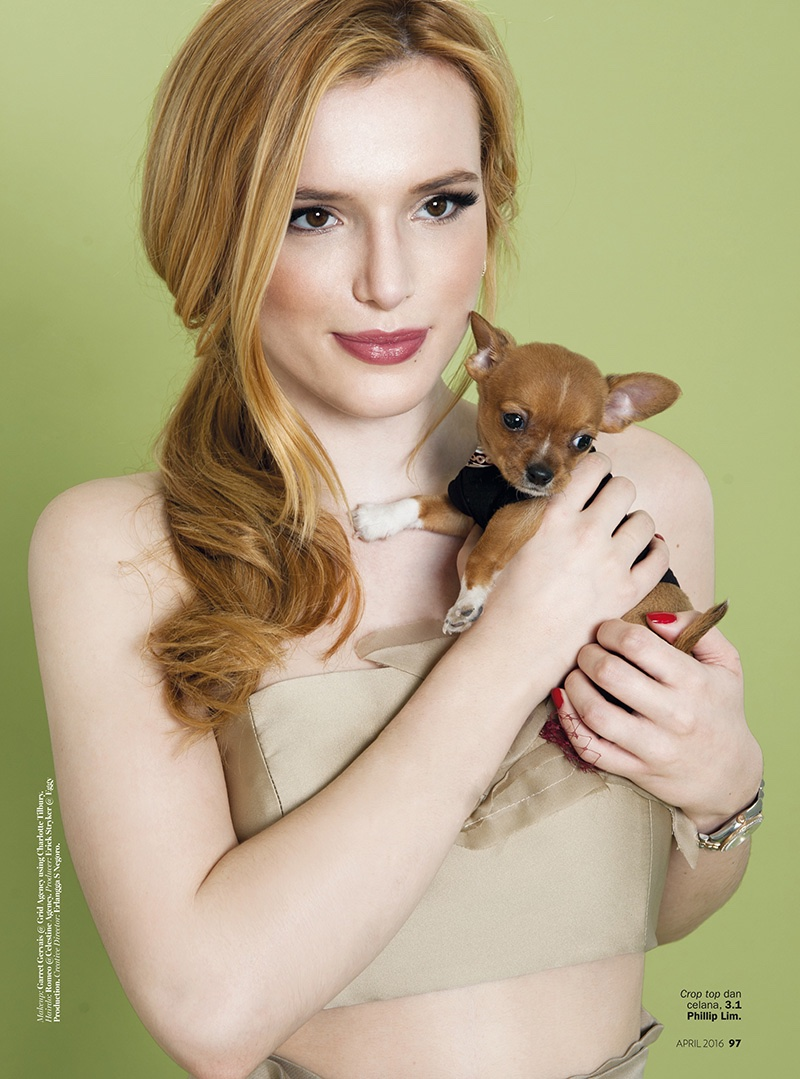 Posing with her dog, Bella Thorne wears a 3.1 Phillip Lim strapless top and skirt