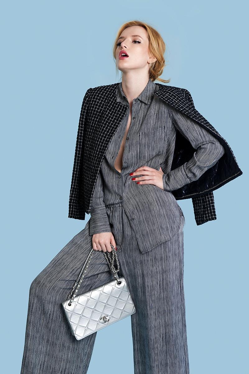Suting up, Bella wears grey pantsuit with a black jacket