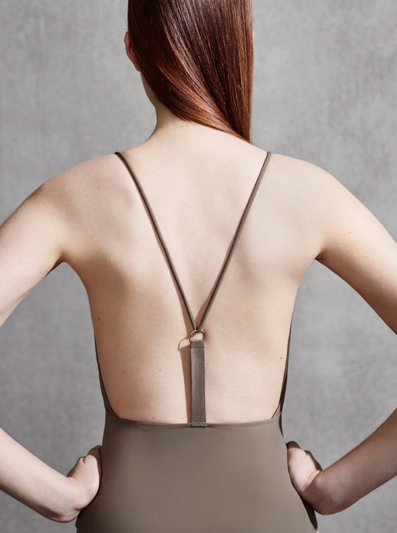 A one-piece swimsuit from COS features a Y-shaped back