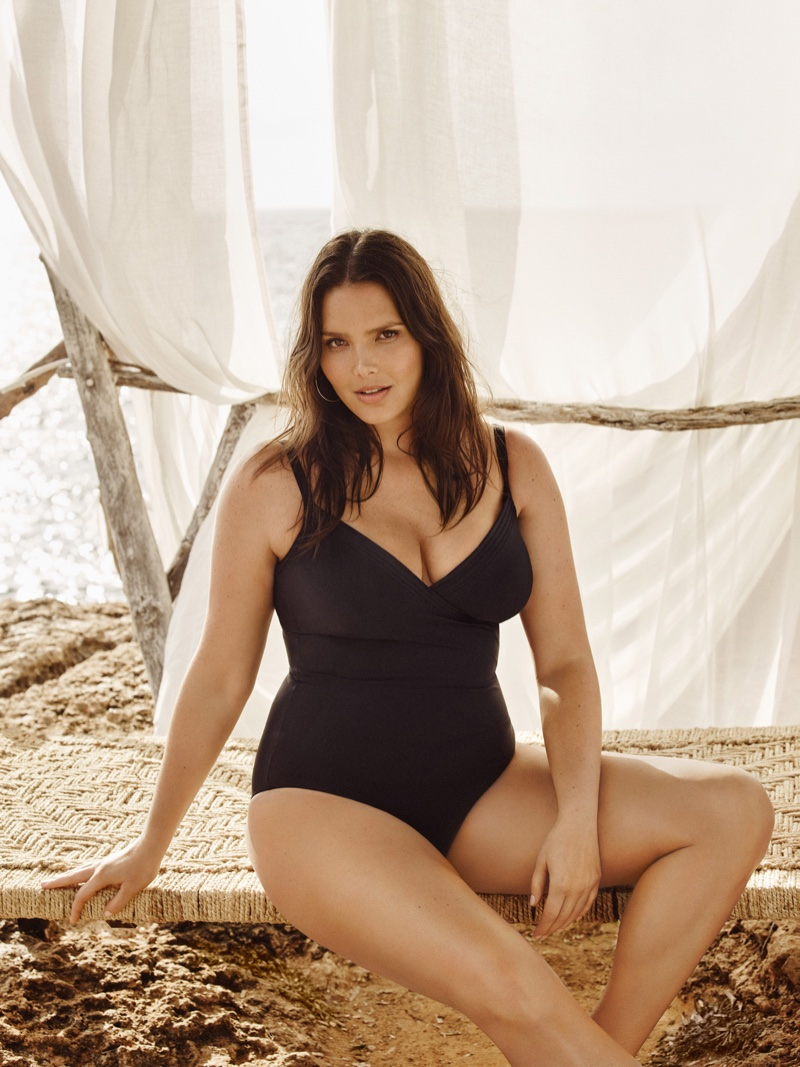 Candice Huffine flaunts her curves in a black one-piece swimsuit from Violeta by Mango