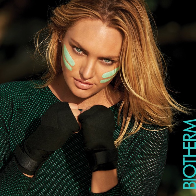 Candice Swanepoel puts on some face paint for Biotherm