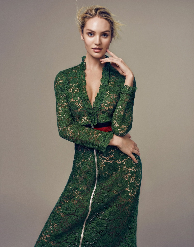 Candice Swanepoel models a green lace Gucci dress with a red belt