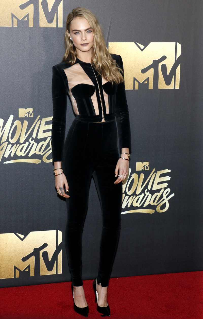 Cara Delevingne wore a black top and pants from Balmain. Photo: Tinseltown / Shutterstock.com