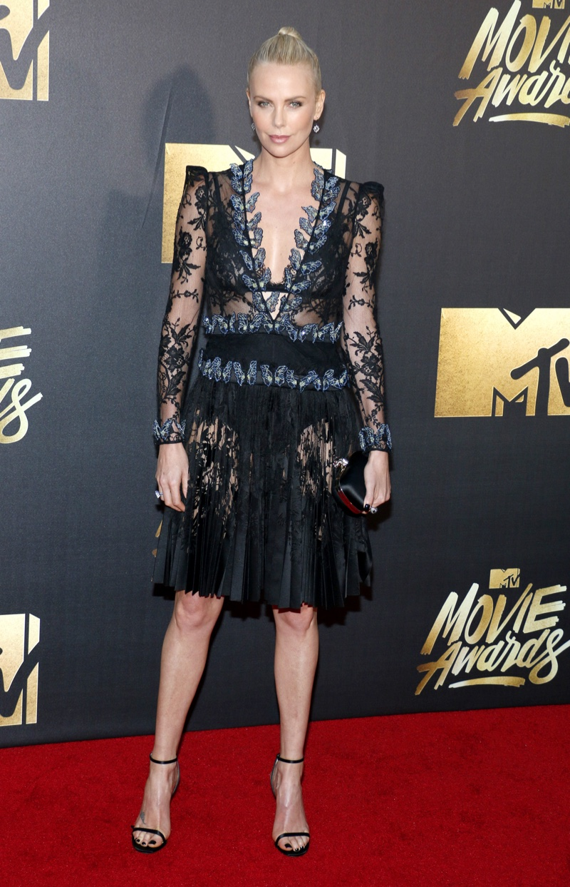 Charlize Theron wore an Alexander McQueen dress with sheer detail. Photo: Tinseltown / Shutterstock.com