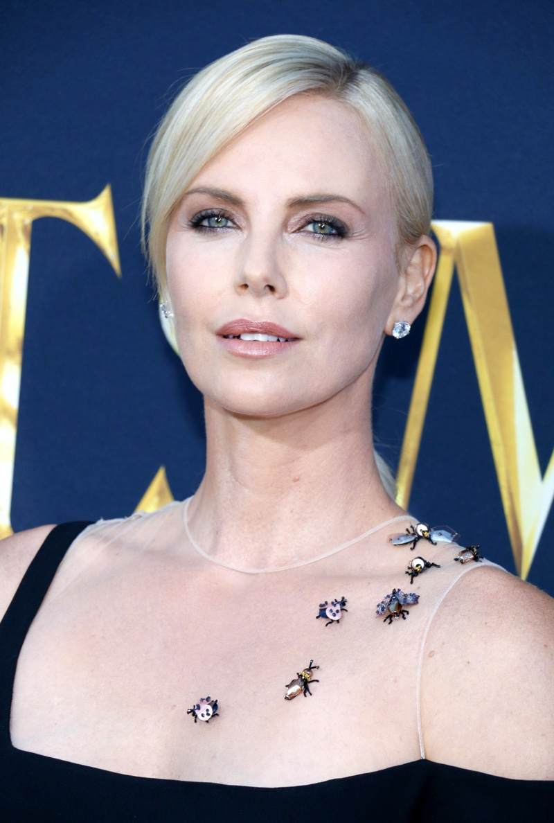 APRIL 2016: Charlize Theron attends The Huntsman: Winter's War Los Angeles premiere wearing Harry Winston earrings. Photo: Tinseltown / Shutterstock.com