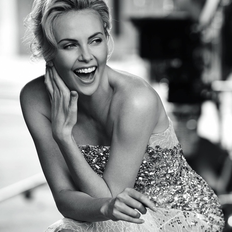 Charlize Theron is all smiles behind the scenes at J'adore Dior fragrance shoot.