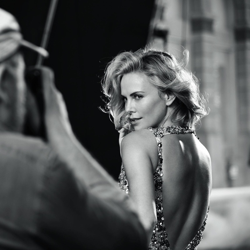 Charlize Theron poses behind the scenes at J'adore Dior campaign