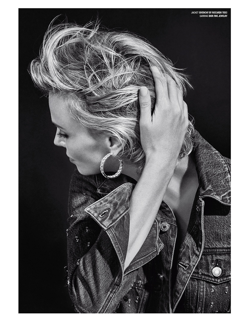 Photographed in black and white, Charlize wears a Givenchy by Riccardo Tisci denim jacket