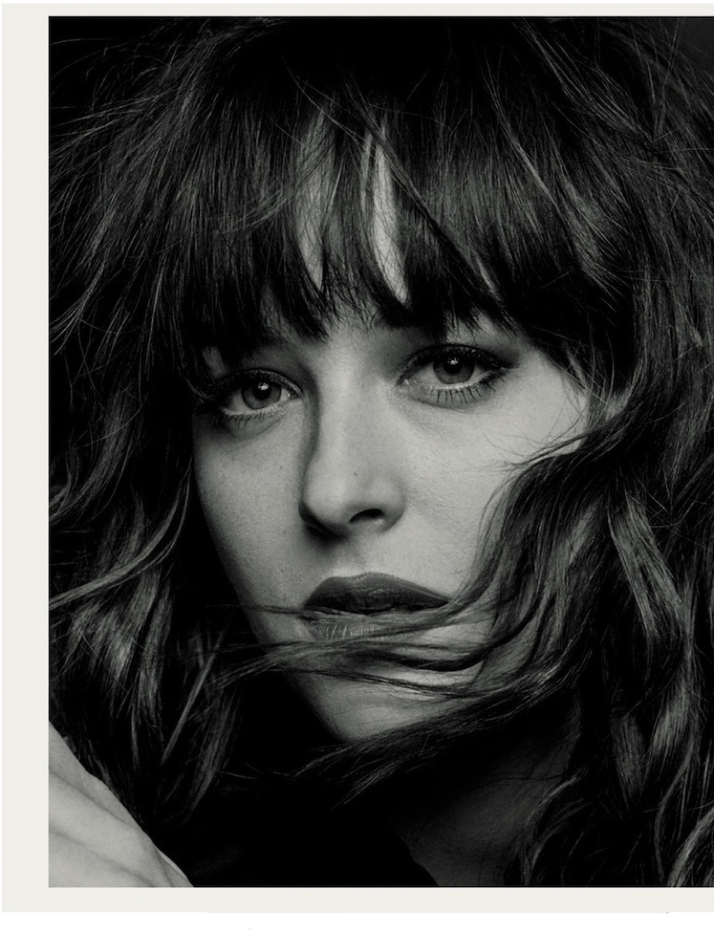 Dakota Johnson gets her closeup with a wavy hairstyle featuring full bangs